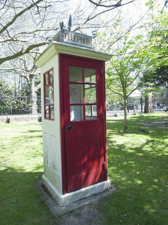 Portsmouth Museum: An early 20th century phone box in the garden in front of the museum