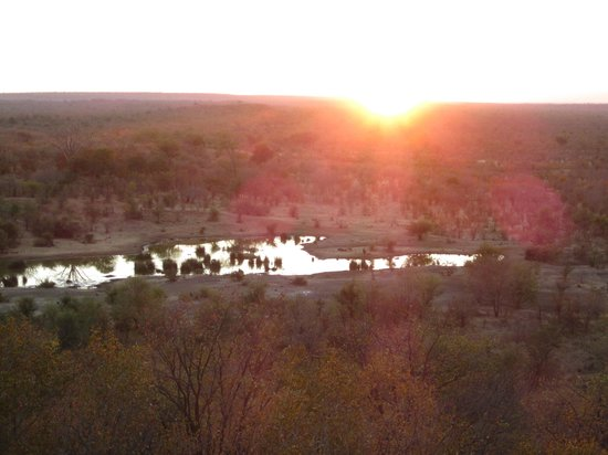 Victoria Falls Safari Lodge: Sunset over the watering hole.