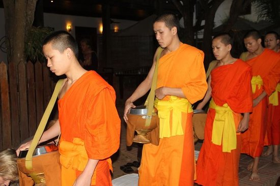 Hotel 3 Nagas Luang Prabang MGallery by Sofitel: The Monks in front of the 3 Nagas Hotel