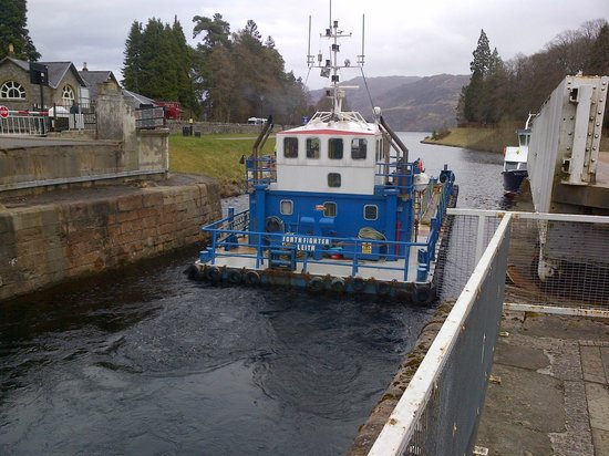 Tigh Na Bruach: A large barge navigating the locks on the Caledonian Canal