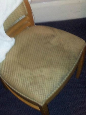 Euro Queens Hotel: Chair in our room!!