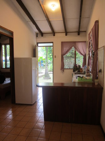 Cabinas Caribe Luna : Looking to the kitchen from the living area (with unused TV)