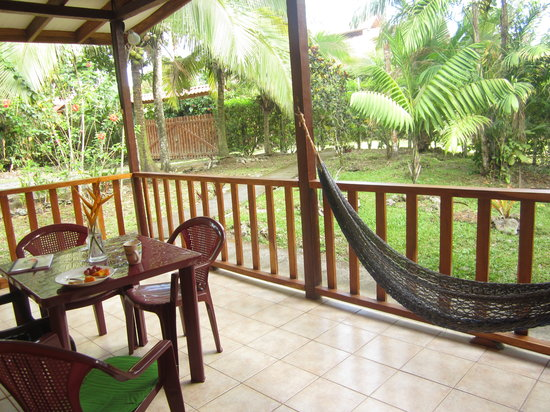 Cabinas Caribe Luna: Massive deck surrounded by gardens with hammock