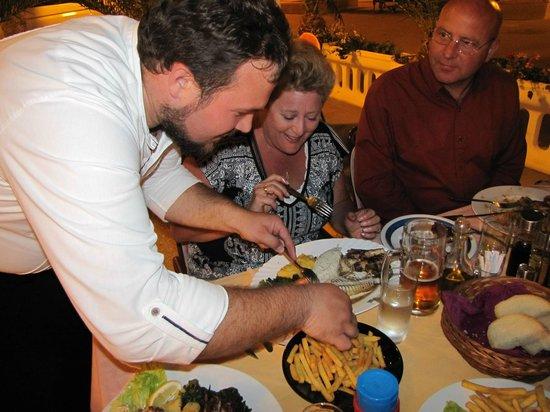 Restoran Fontana: Vicko helping with the fish platter!