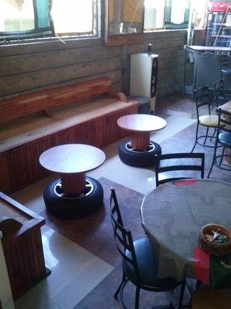 Camp Barnados Restaurant: Our unique decor includes our tire rim tables.