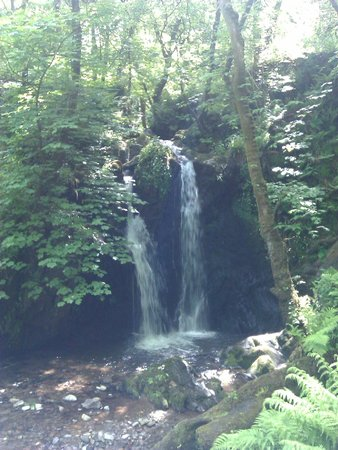 Glan House: waterfall on foot path to cove