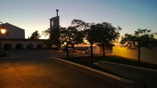 Betica Hotel Rural : Sunset over the church plaza out of the Betica window