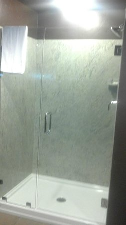 The Hotel at Black Oak Casino : Walk in Granite Shower w/ glass door.