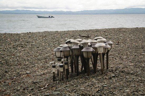 Playa Nicuesa Rainforest Lodge: charging solar lanterns on the beach