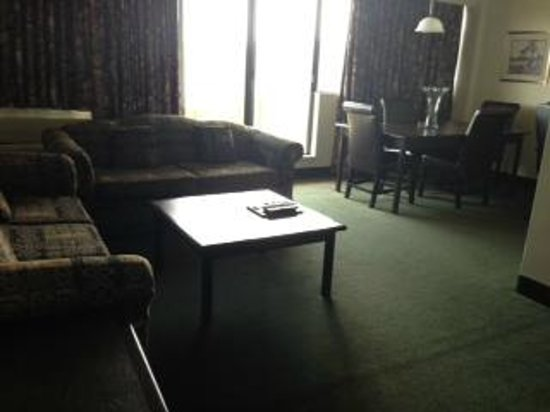 The Business Inn & Suites: Living and Dining Rooms
