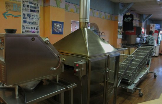 Charlie's Bakery and Cafe: The tortilla machine warming up