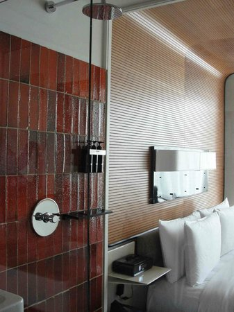 The Standard, High Line: Shower with clear wall, bed & sitting area