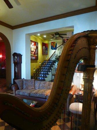 La Perla Hotel Boutique B&B: Lyon and Healy Harp in Living room