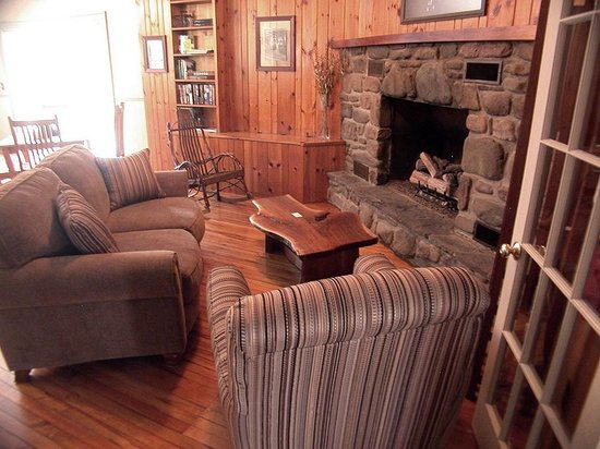 Comfortable seating by the stone fireplace