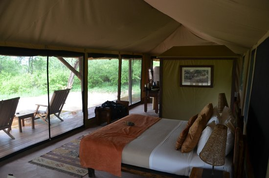 "Oliver's Camp, Asilia Africa: Our gorgeous ""tent"" with a lovely outdoor shower."