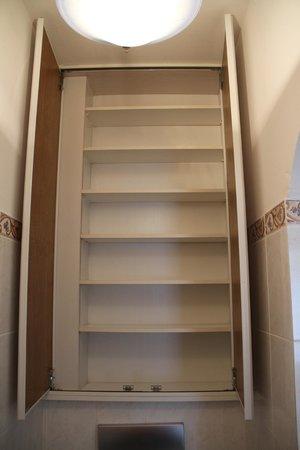 Hotel Shegara : Abnormally high bathroom shelves. Great for stashing stuff!