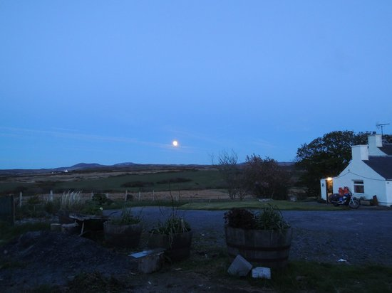 Moon rising above Ayen Cottage (to the right)