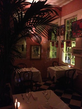 Upperline Restaurant: The center dining room with romantic lighting and palms.