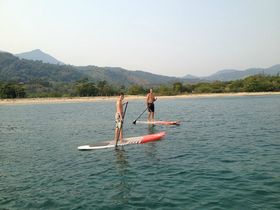 Tranquility Bay Beach Retreat: Paddle boarding in front of the retreat property.