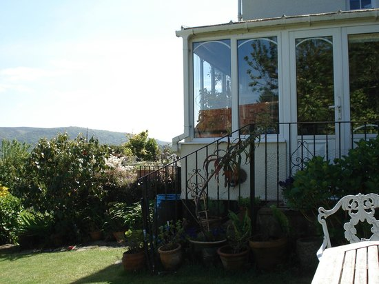 Mariners Lodge: From Garden across Corner of Conservatory
