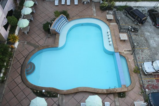 Lancaster Hotel Cebu: View of the Swimming Pool from our 6th Floor Condotel Unit