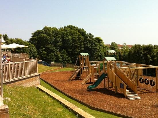 Parkdean - Torquay Holiday Park: Kids play area and patio bar sun terrace