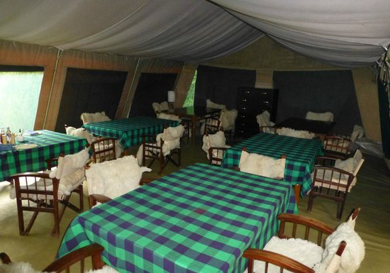 Nairobi Tented Camp: The mess tent with super sheepskin throws on chairs
