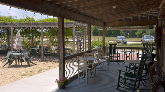 The Winery at Iron Gate Farm: Another porch view of the rustic wine and tasting building