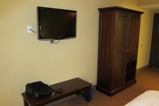 Sheraton Jacksonville: TV and clothes closet (with iron and ironing board)