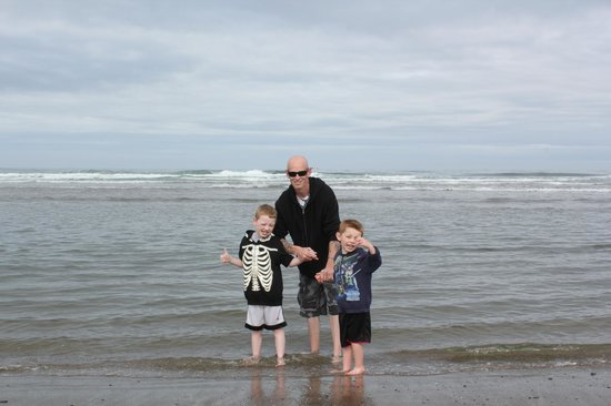 Pelican Shores Inn: My boys and myself enjoying the Ocean water.