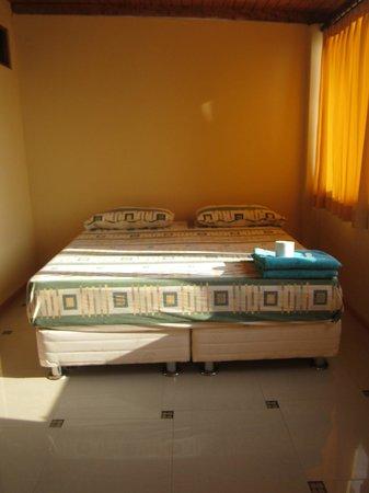 Agetaway Hotel: suite con cama king , vista al mar