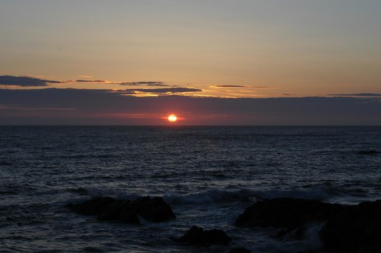 Looking across Woolacombe Bay towards Lundy Island at sunset