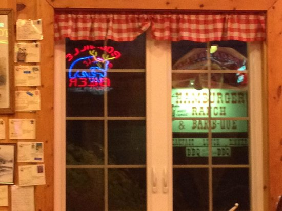 Hamburger Ranch & Bar-B-Que: Looking at the sign from inside, postcards on wall