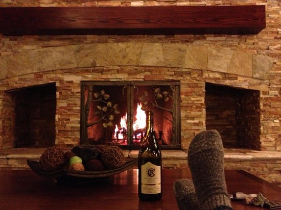 Olympic Lodge : Feet up, comfy couch, crackling wood fire and wine. What 's not to love?