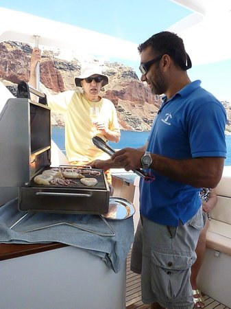 Santorini Sailing: Captain Theo with steak and shrimp on the barbecue. It was a gourmet lunch.