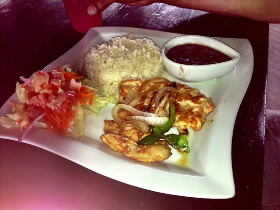 Omar's: Grilled chicken, rice and stewed beans with a side salad
