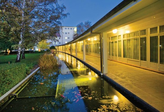 University House: View of the Fish Pond at Dusk