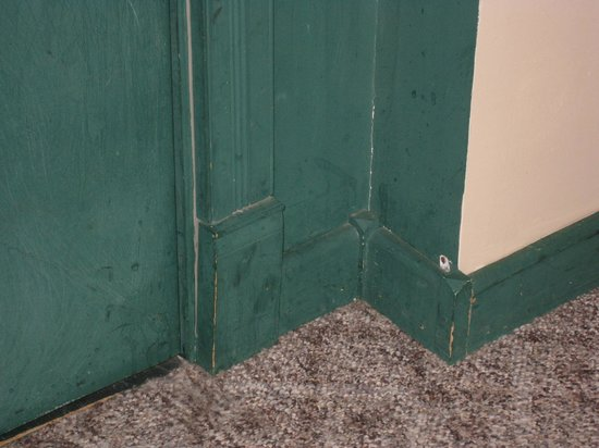 Deadwood Dick's: Filthy door and trim where it looks like dogs have repeatedly scratched.