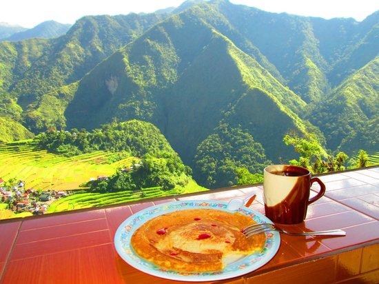 Uncharted Philippines Adventure Travel and Day Tours: sumptuous breakfast while overlooking the hills with rising sunshine