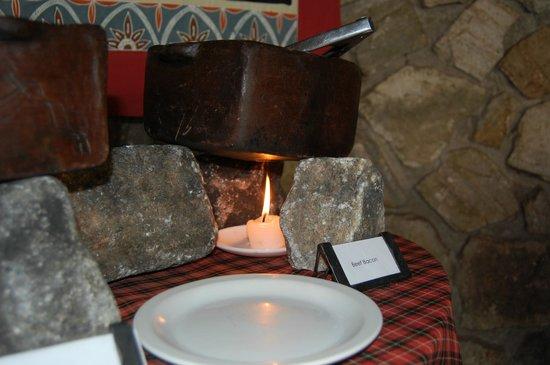 Tarangire Safari Lodge : Large stones holding bowls for meals
