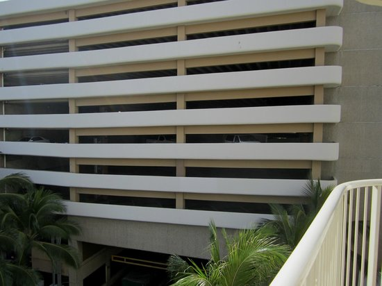 "Wyndham at Waikiki Beach Walk : ""Exotic"" view from our balcony (a parking garage)"