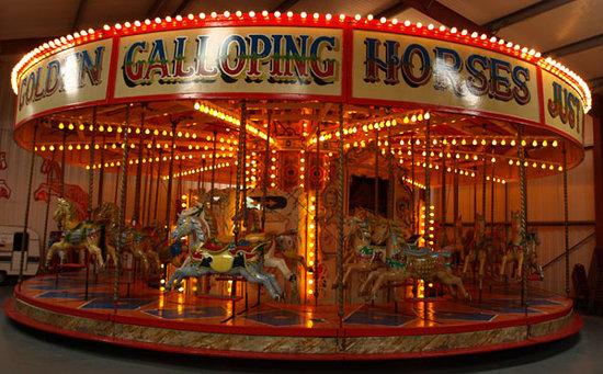 The Scarborough Fair Collection: golden galloping horses carousel