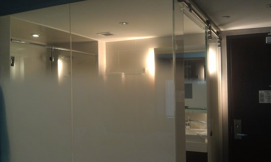 The J House Greenwich: Privacy glass seperating bathroom