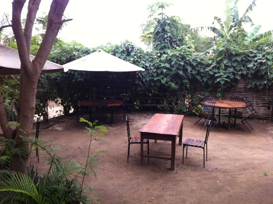 Logali House: Outside restaurant / seating area
