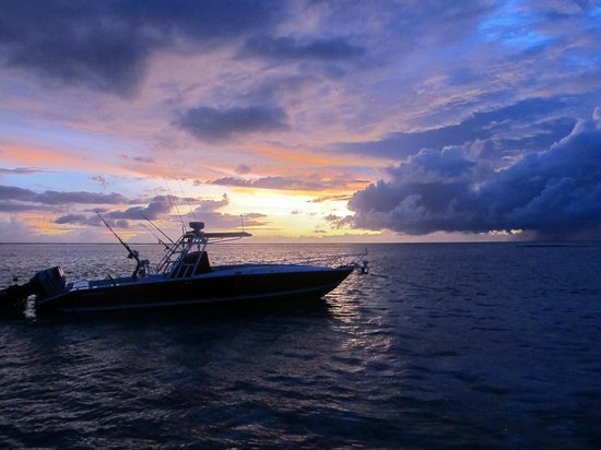 Tikehau Ninamu Resort: Chris' boat at sunset