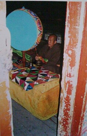 Dailuo Ding of Wutai Mountain: monk beating time on Tibetan Drum in morning prayers