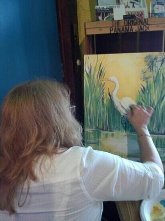 Banana Cabana Caribbean Grill: just a sample of some talent artist that come in to raffle off their beautiful art