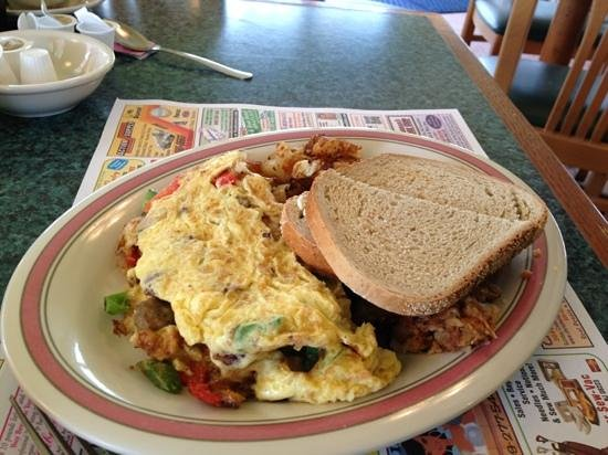 Augie's Omelette & Waffle : country omelet sausage/bacon/onions/peppers/cheese with potatoes