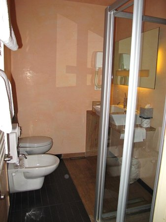 Grand Hotel Cavour: A bit tight. Careful to shut the shower stall properly while using it.