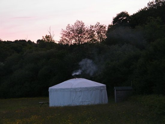 Cuckoo Down Farm: The yurts at night with the stove lit